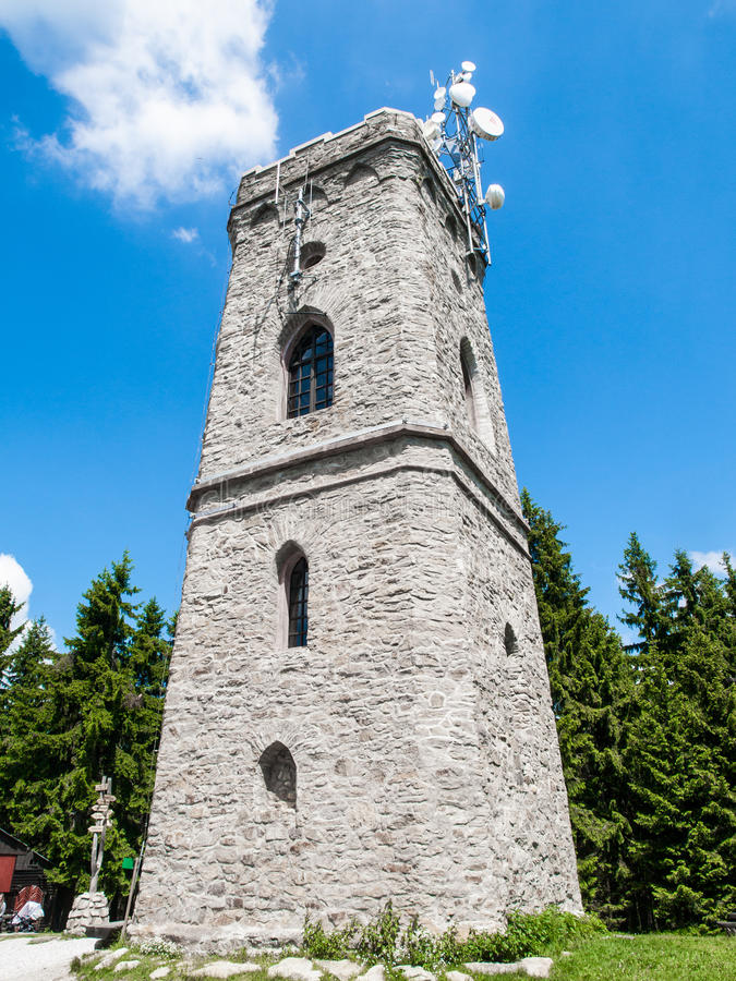 Old stone lookout tower Zaly in Giant Mountains, Krkonose, Czech Republic stock photo