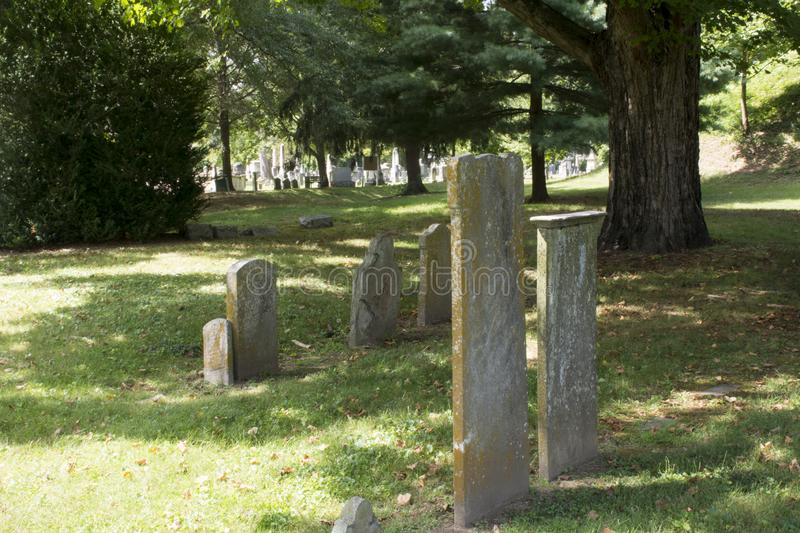 Old stone markers. Rows of headstones in perhaps the oldest cemetery West of the Ohio river. The Mound Cemetery in Marietta Ohio contains many revolutionary war royalty free stock image