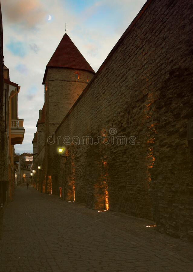 Old stone medieval street in the historic part of the city Tallinn at night. Estonia royalty free stock image