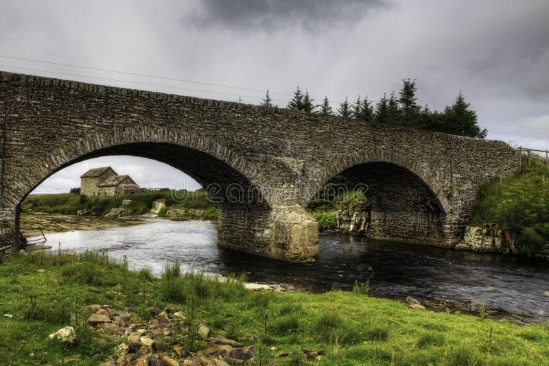 An old stone mill and bridge in Thurso, Scotland stock photo
