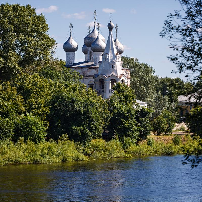 Old stone Orthodox Church on the banks of the river in Russia.  royalty free stock photography