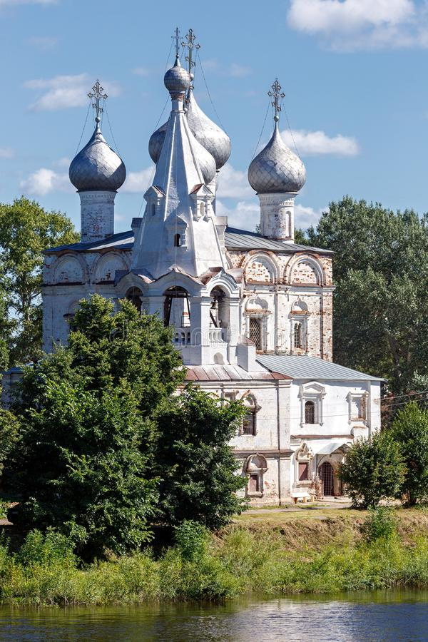 Old stone Orthodox Church on the banks of the river in Russia.  stock photography