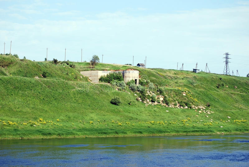 Old stone quarries the banks of the river of Volga located lengthways in the city of Staritsa. Tver region. Russia. Old stone quarries the banks of the river of stock photography