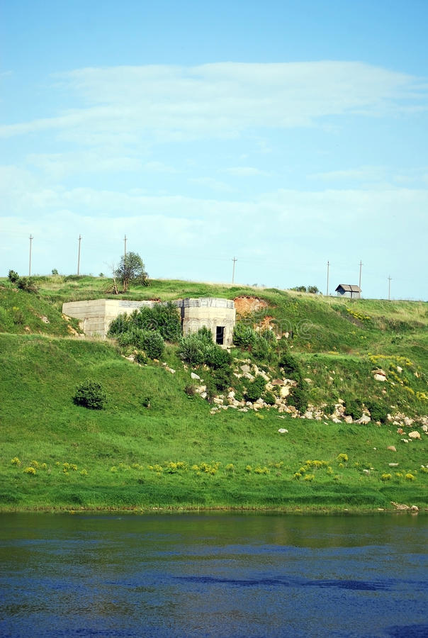 Old stone quarries the banks of the river of Volga located lengthways in the city of Staritsa. Tver region. Russia. Old stone quarries the banks of the river of royalty free stock photography