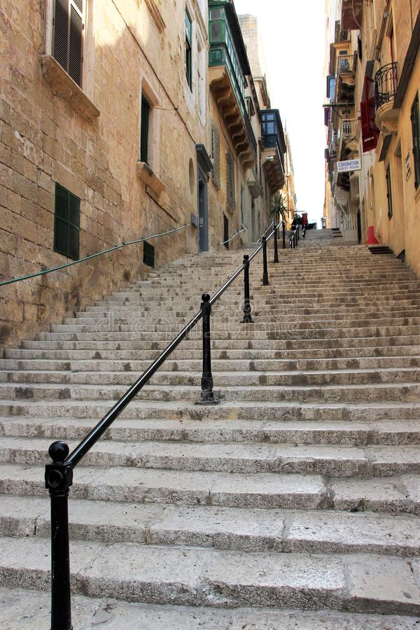Senglea, Malta, July 2016. The stone stairs are the street leading to the city center. royalty free stock image