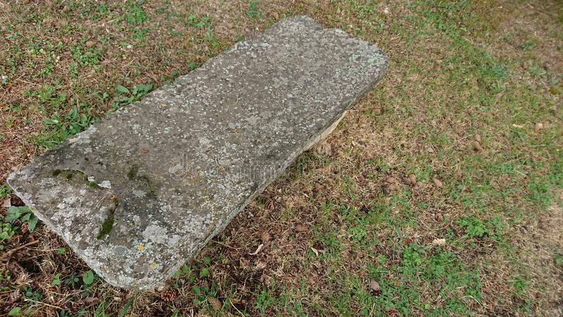 Stone Seat On Cut Grass royalty free stock photo