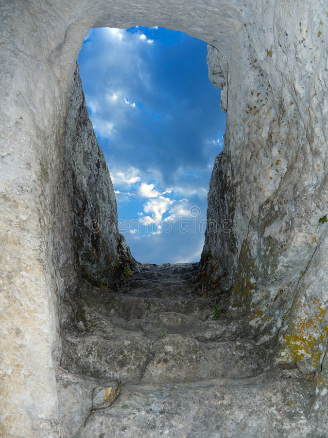 Old stone staircase to sky. Old stone staircase from cave to sky stock image