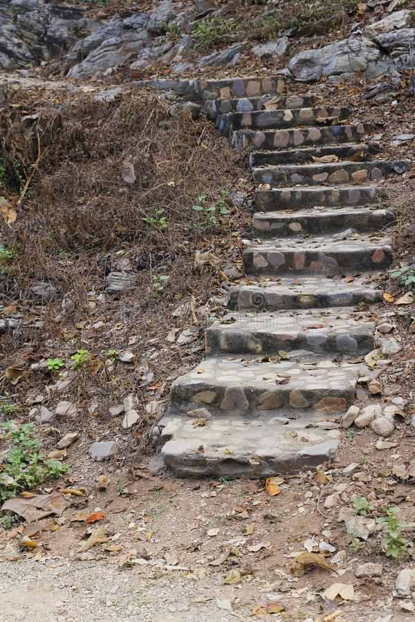 Old stone stairs up hill royalty free stock photos