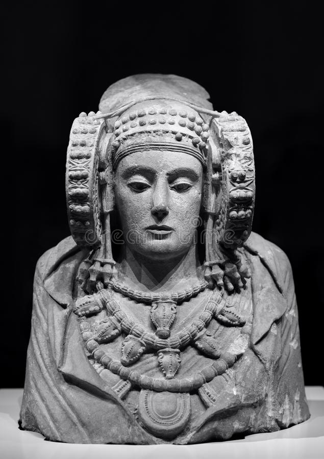Old stone statue of the lady. Stone statue of the lady of elche, iberica culture on black background. Black and white photography with free space for text above royalty free stock photography