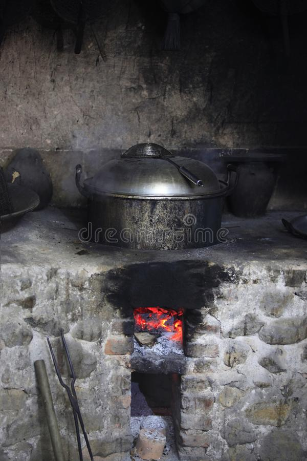 An old stone stove with an saucepan. An old stone stove with an old saucepan. China royalty free stock images