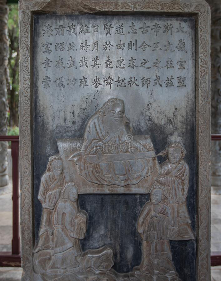 Old stone tablet in honor of Confucius in Confucian Temple, Jianshui, Yunnan, China royalty free stock image