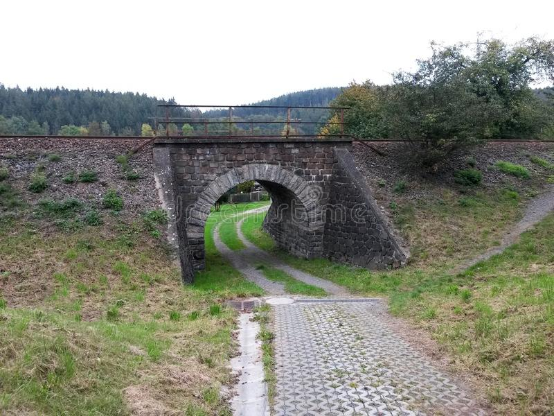 Old stone underpass under the railway track stock photos