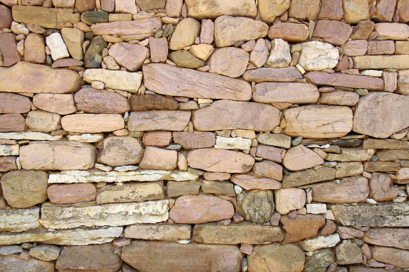 Old stone wall. Beautiful detail from the village stock photo