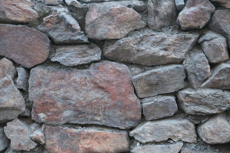 Old stone wall. Abstract background, stone wall, old wall, dirt stone, pieces of marble stock photo
