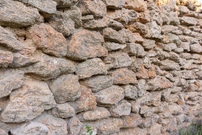 Old stone wall background. Texture rock wall of ancient wall stock images