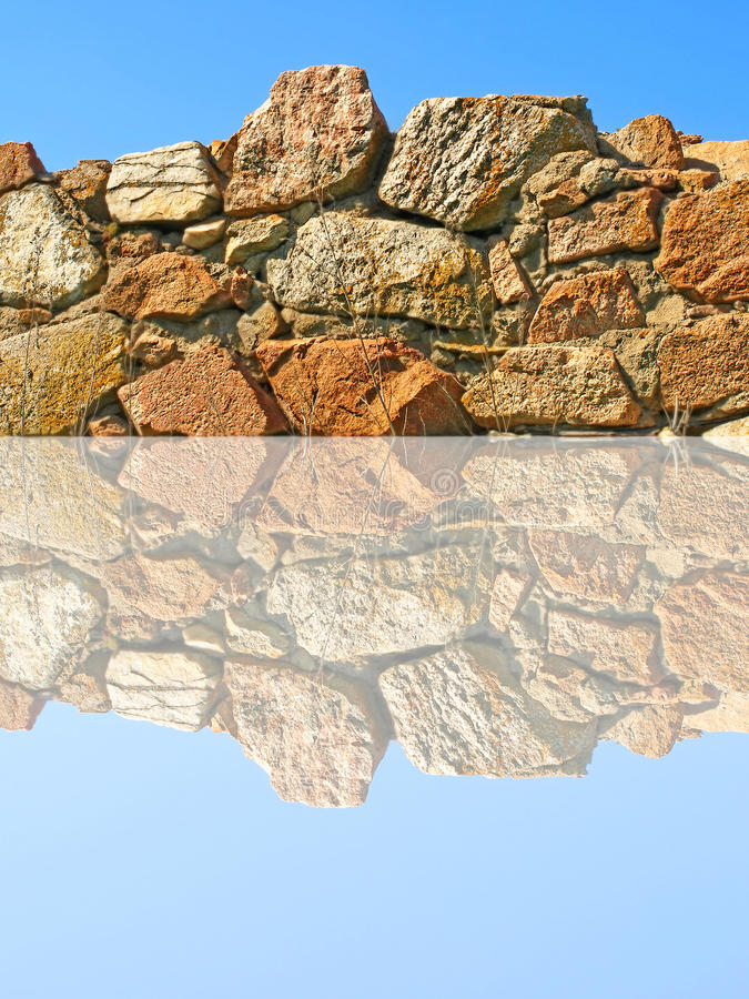 Free Old Stone Wall Being Reflected In Water. Royalty Free Stock Photo - 31465945
