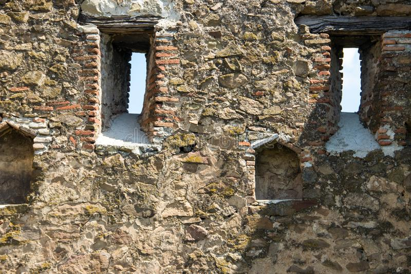 Old stone wall of castle or fortress close-up stock photos