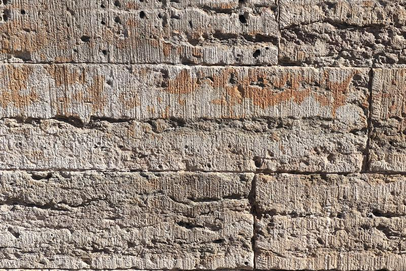 Old stone wall with cracks, natural concrete background, old natural texture of an ancient stone. It is used for decoration of. Buildings and embankments, a royalty free stock photos