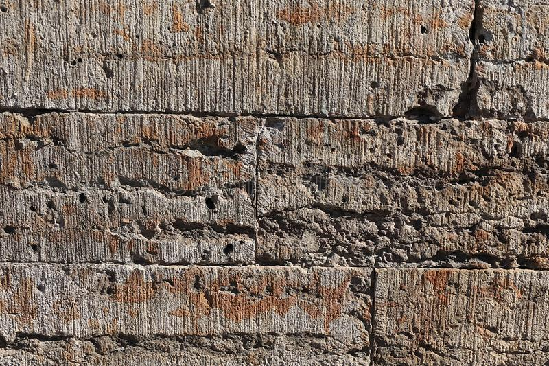 Old stone wall with cracks, natural concrete background, old natural texture of an ancient stone. It is used for decoration of. Buildings and embankments, a royalty free stock images