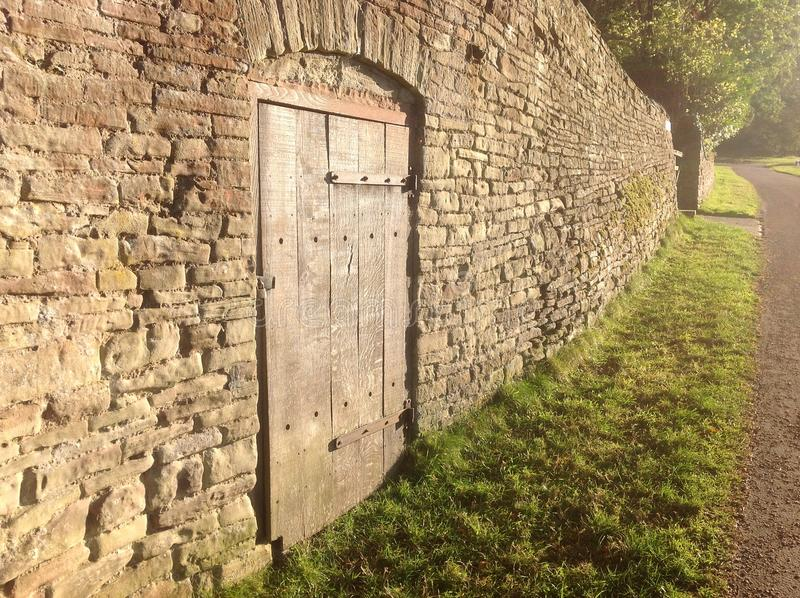 Old stone wall with door stock image