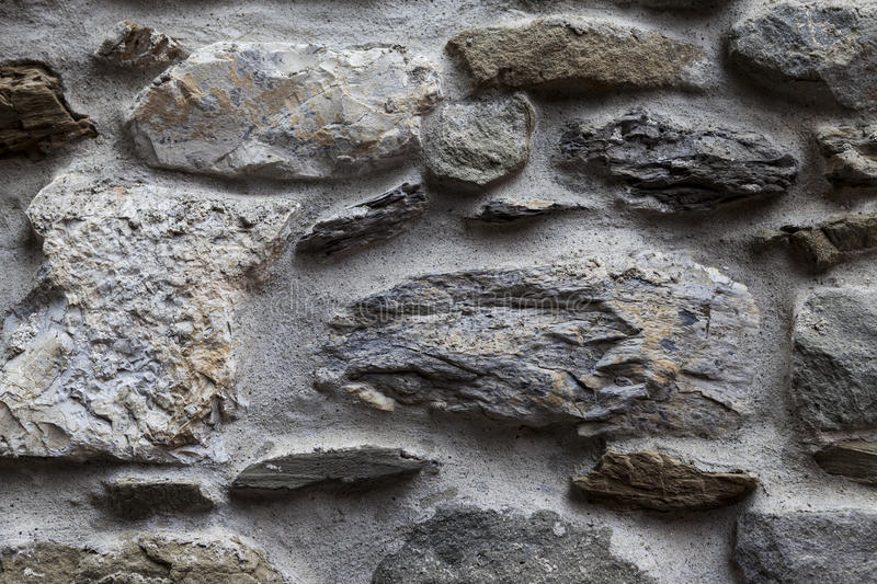 An old stone wall gray large stones. Classical masonry walls of medieval castles in Europe. royalty free stock photos