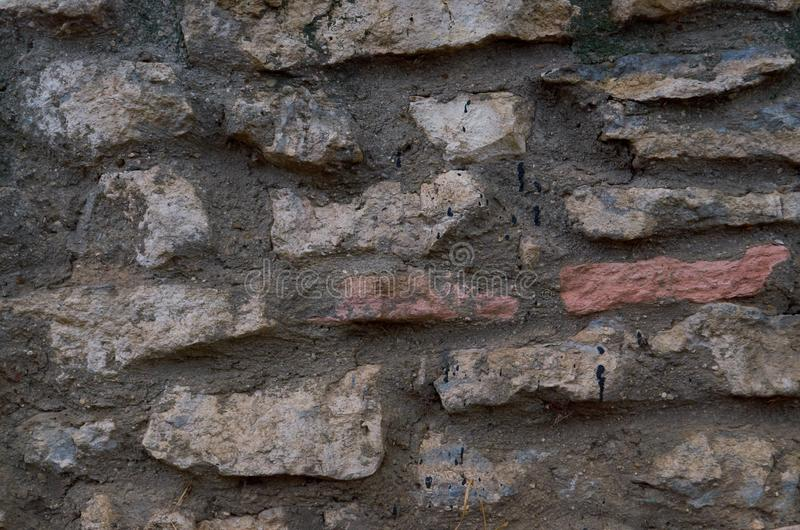 Old stone wall outdoors for background, texture. Natural stone masonry royalty free stock image