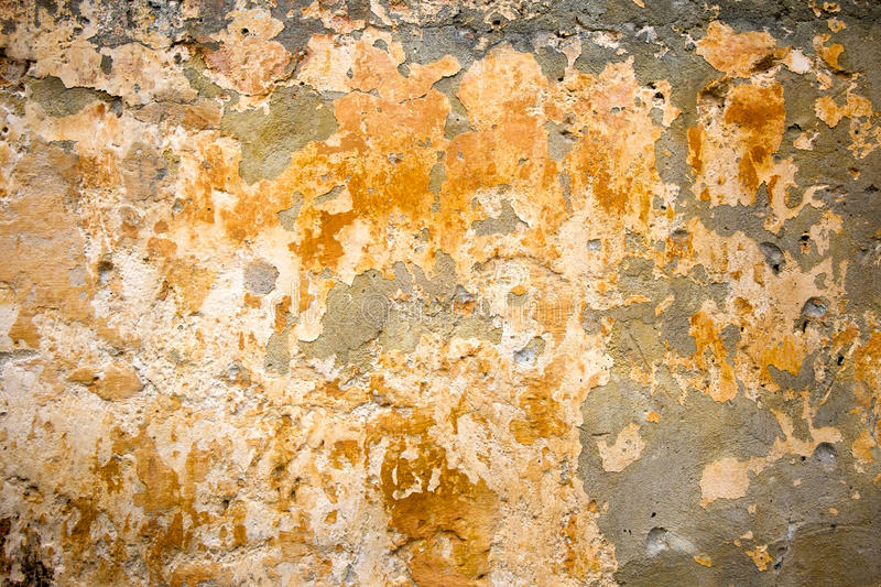 Old stone wall texture background. Colorful and cracked, toned stock photos