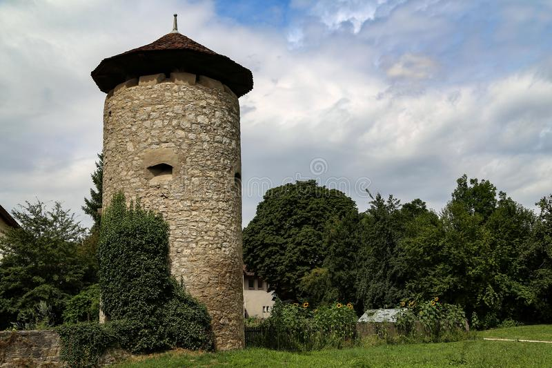 The old stone watchtower in the city stock images