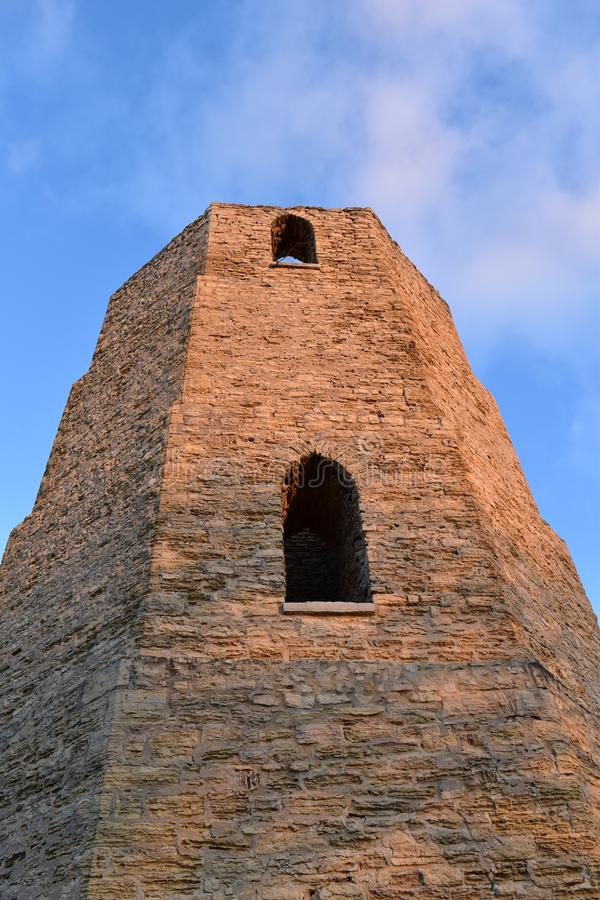 Old stone water tower lit by the rising sun royalty free stock photography