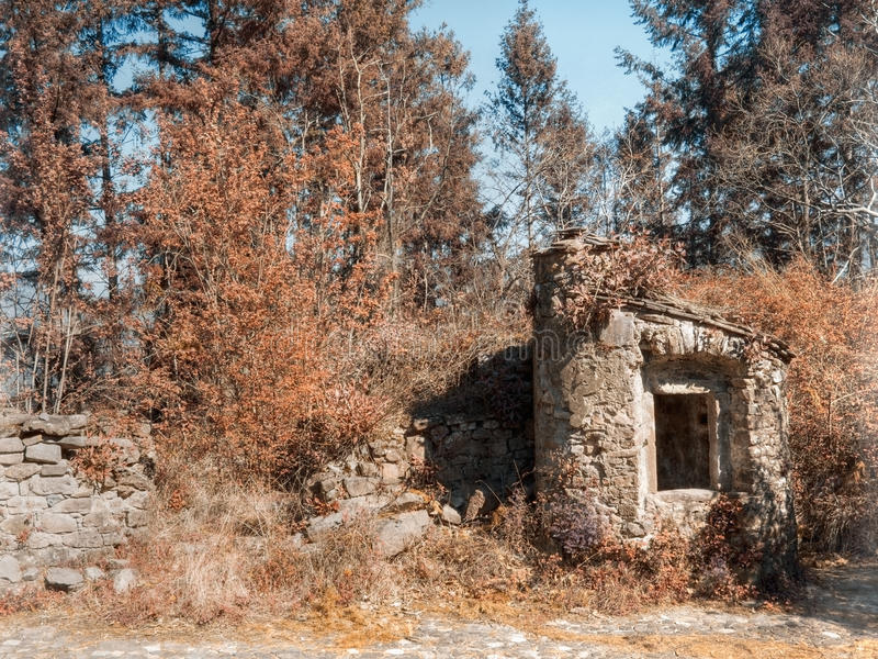 Old stone well in abandoned village, Italy stock images