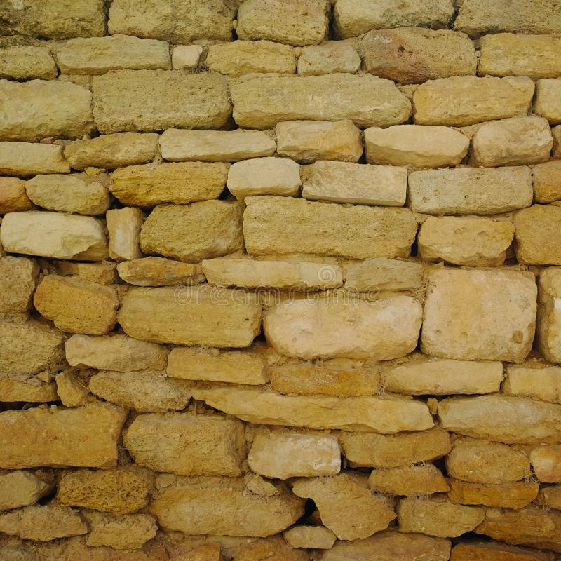 Old stones urban wall texture, wallpaper, designer template stock photos