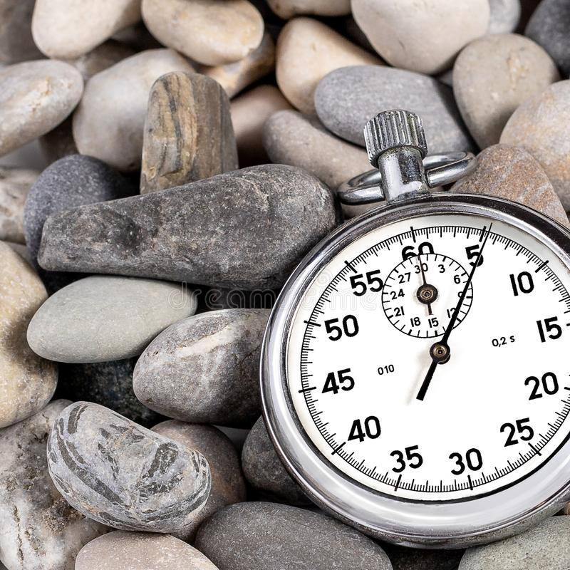 Old stopwatch on stones royalty free stock photo