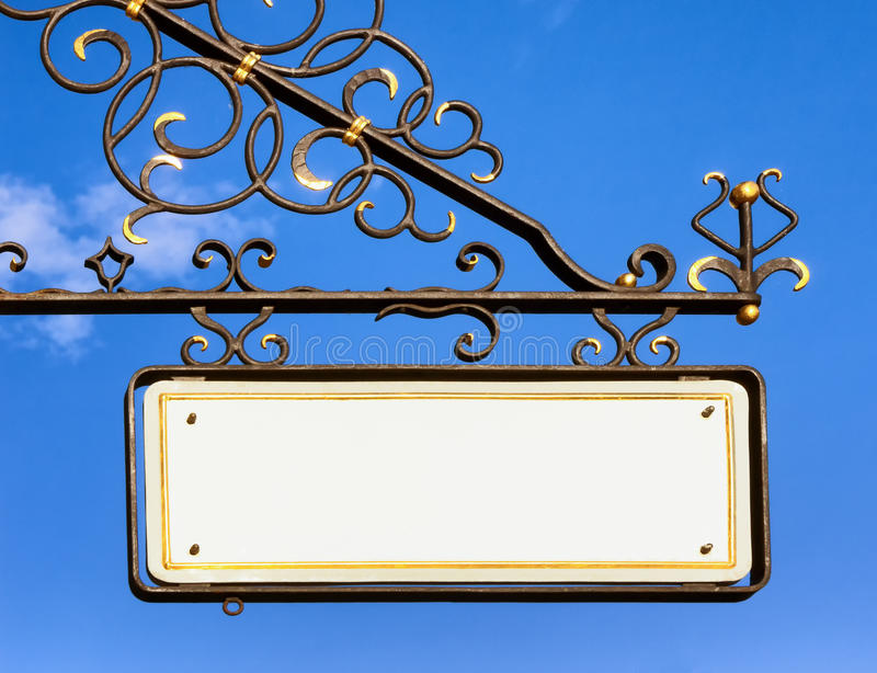 Old store sign. Beautiful old store sign in front of sky royalty free stock image