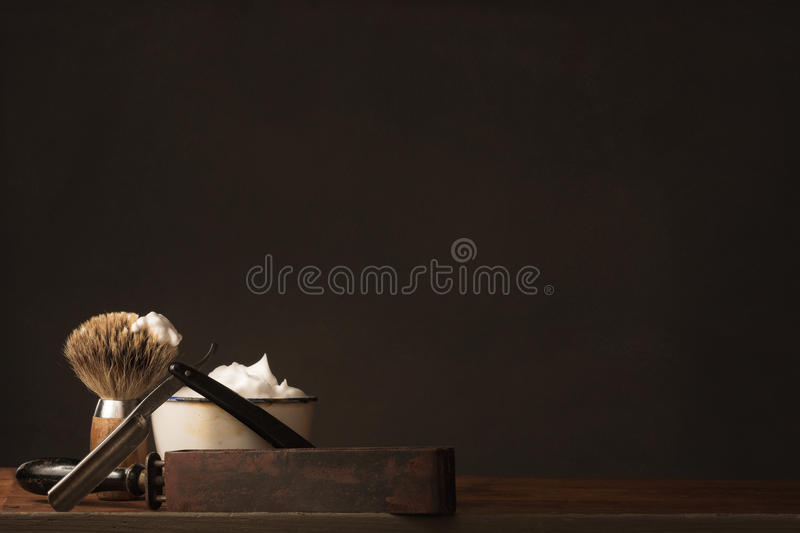 Old straight Razor with Brush, Strop and Shaving Soap royalty free stock image