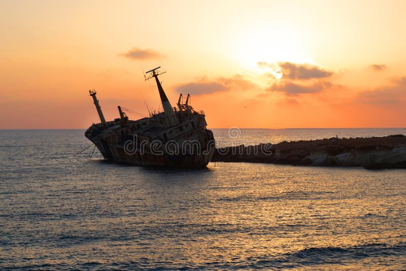 Old stranded ship at sunset. Paphos. Cyprus. Old stranded ship at sunset. Sea caves in Peyia, Paphos. Cyprus stock photography