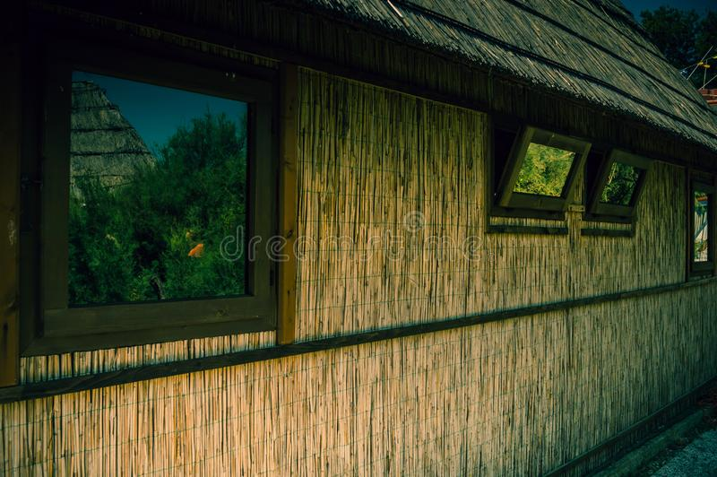 Old straw fishing house in detail. Close up stock photos