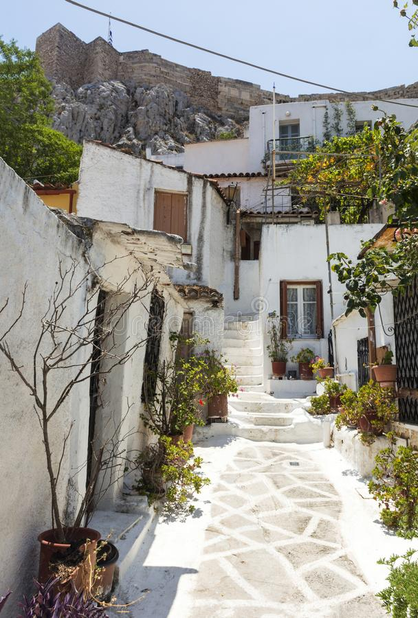 Old street in Athens at the foot of the Acropolis, Greece, white buildings. Sunny day royalty free stock images