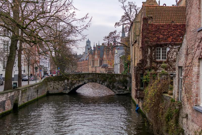 Old street of Bruges with traditional medieval houses stock image