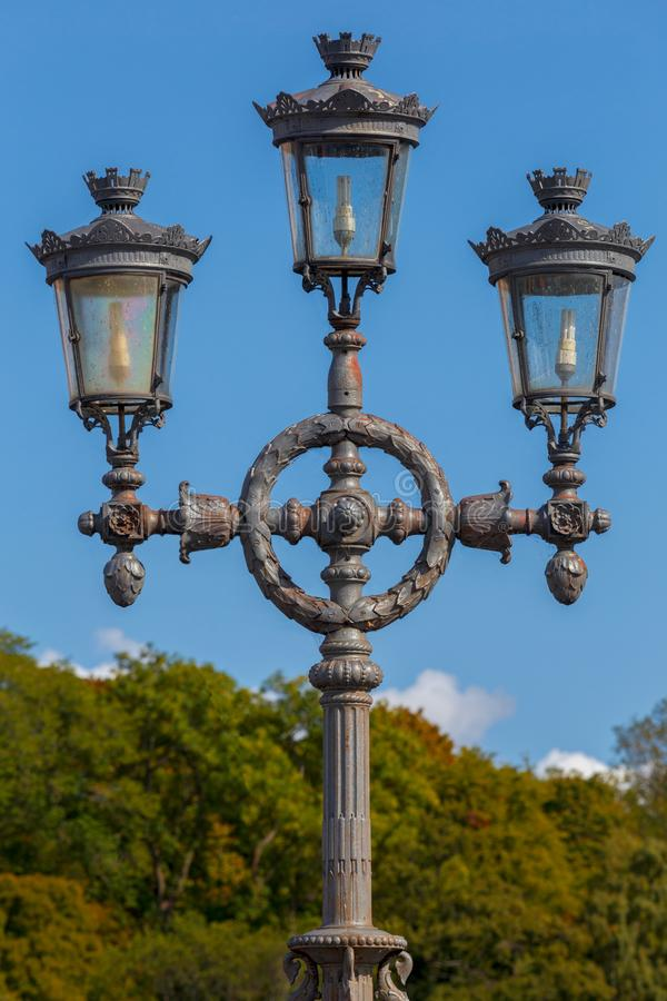 Free Old Street Lamp In The Park Against The Sky. Royalty Free Stock Photography - 128438297