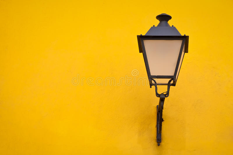 Old Street Lamp On A Yellow Wall Stock Images