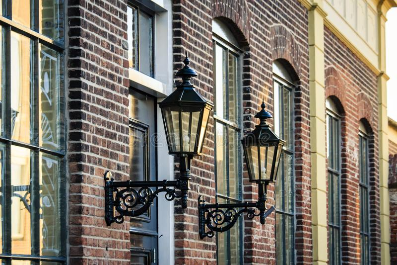 Old street lanterns on a historic building royalty free stock images