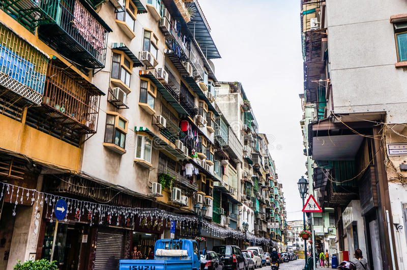 Old street of macau. With motor cycles parked on the right and pedestrian walkway on the left with main road in the middle royalty free stock photo