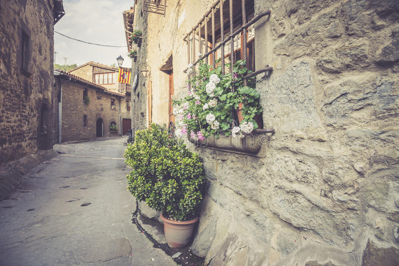 Old street in medieval catalan village stock images
