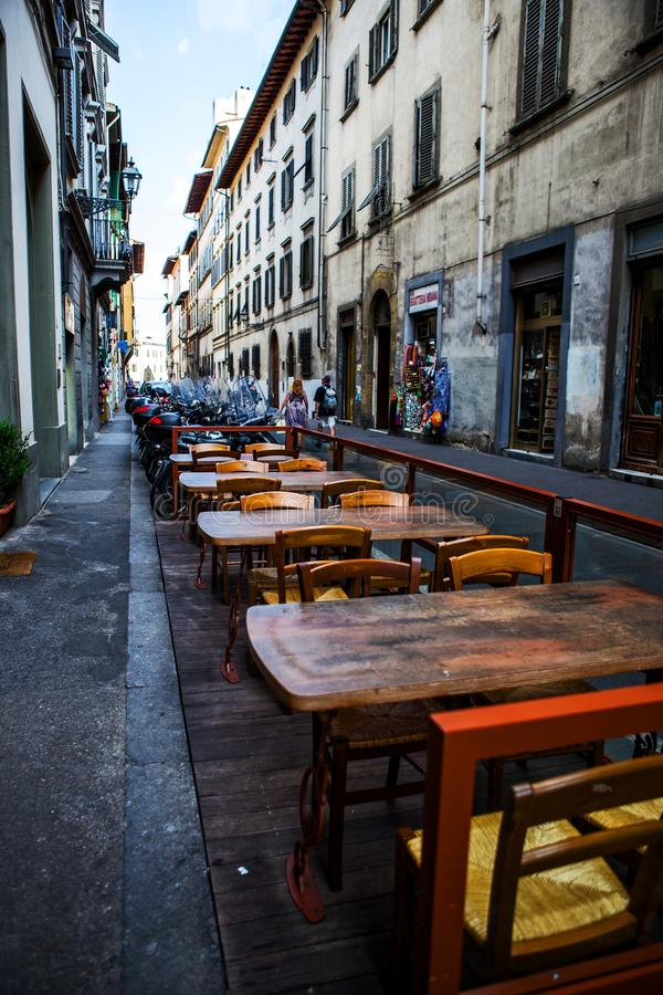 Old street with side street restaurant, Florence royalty free stock photo