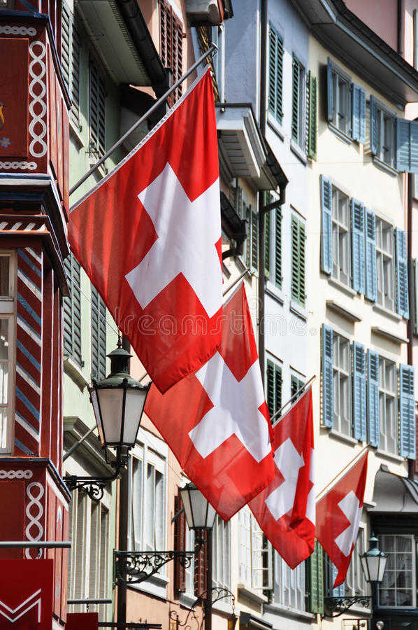 Old street in Zurich decorated with flags. For the Swiss National Day, 1st of August royalty free stock photography