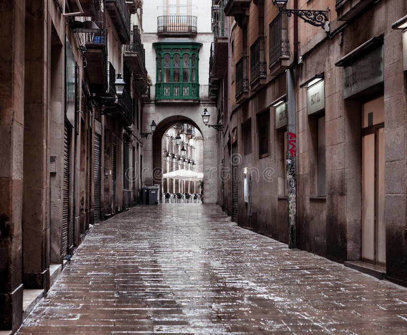 Old streets of Barrio Gotico. BARCELONA, CATALONIA - June 08: Old streets of Barrio Gotico in June 08, 2013 in Barcelona, Catalonia. It is centre of old city of stock photography
