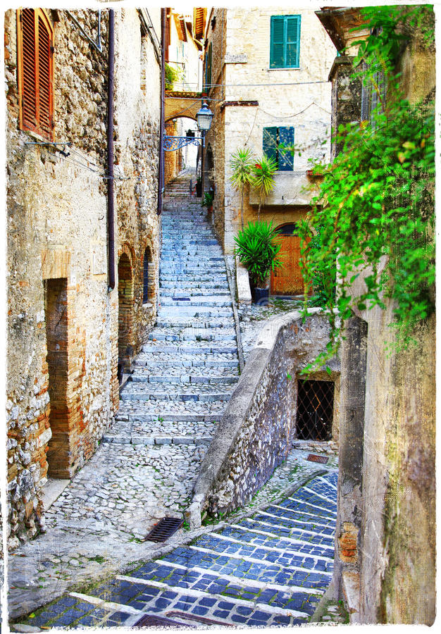 Old streets of medieval italian villages. Beautiful old streets of medieval italian villages, artistic picture stock photography