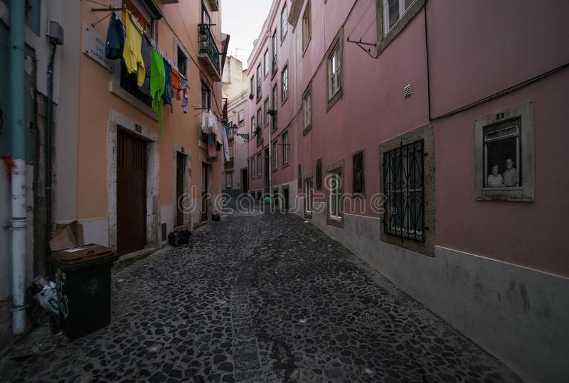 Old streets and the ordinary life of the city of Lisbon. Portugal. As in Lisbon, clothes are dried. Simple life without a beauty. Paving stone on the streets royalty free stock photos