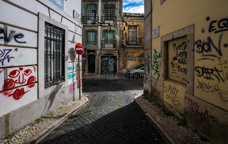 Old streets and the ordinary life of the city of Lisbon. Portugal. Courtyards of Lisbon. Simple life without a beauty. Paving stone on the streets of the city stock photos