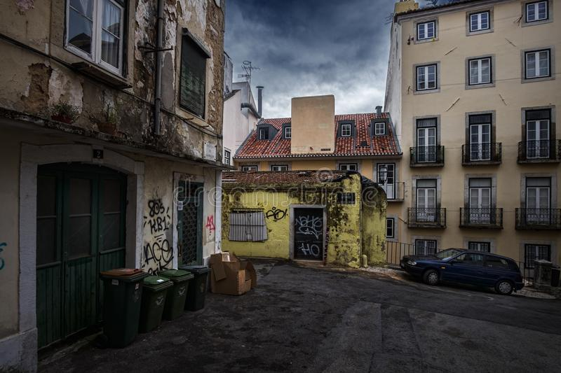 Old streets and the ordinary life of the city of Lisbon. Portugal. Courtyards of Lisbon. Simple life without a beauty. Paving stone on the streets of the city royalty free stock photo
